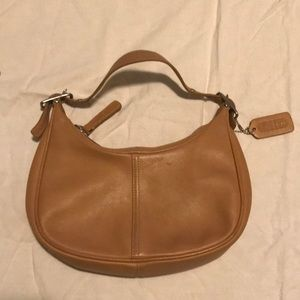 Tan Coach hand purse